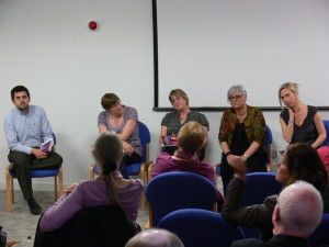Three members of CDoC at a public book discussion